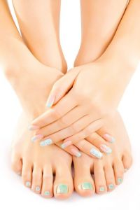 beautiful female feet with turquoise pedicure isolated